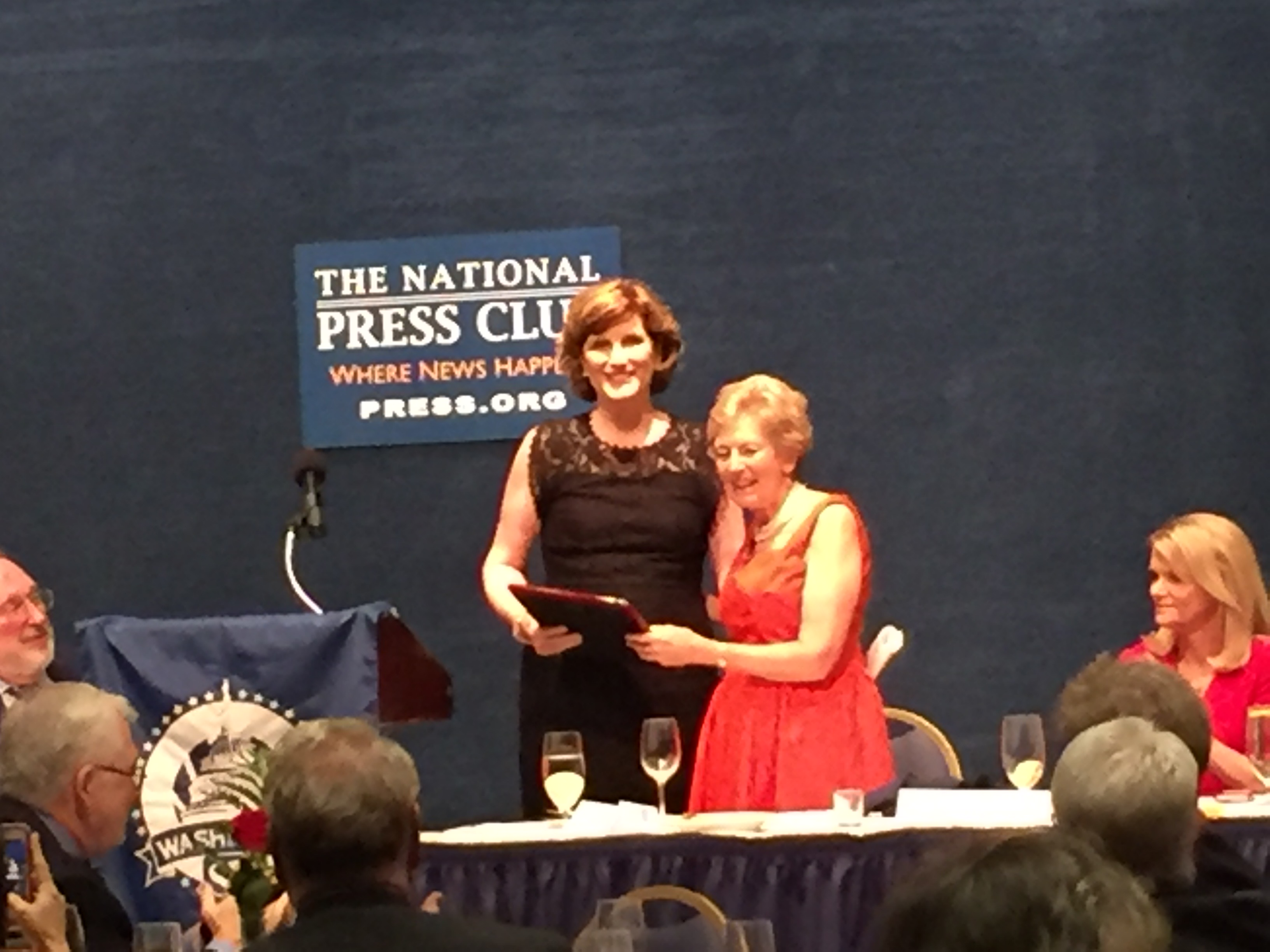2017 Distinguished Service Award winner Lucy Dalglish accepts her plaque from outgoing SPJ-DC chapter president Kathleen Burns